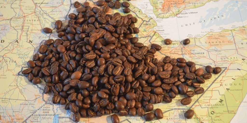 Image of coffee beans on a map of the world.